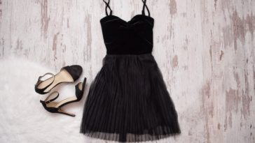 A little black dress with matching high-heeled sandals.