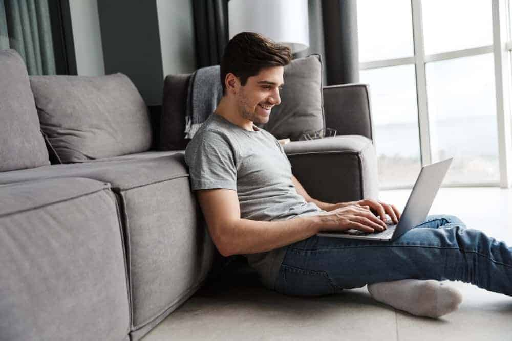 A man lounging in the living room with a linen shirt.