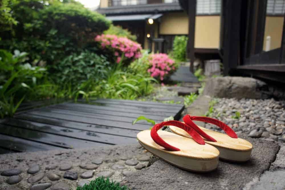 A pair of wooden Japanese sandals at a Japanese ryokan.