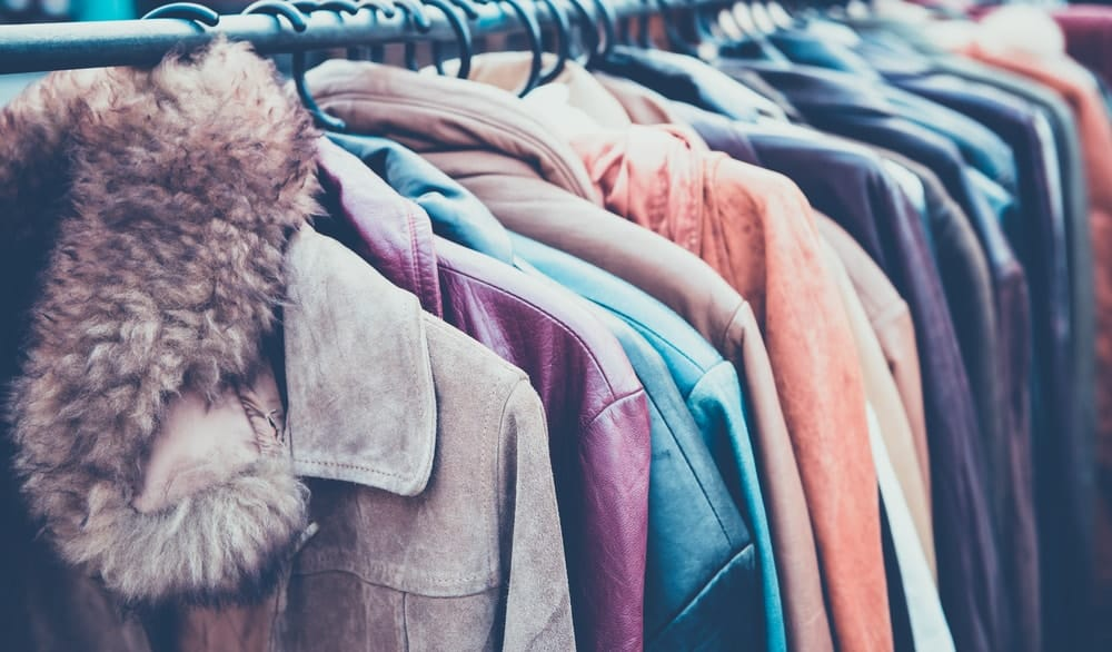 A rack of different coats.