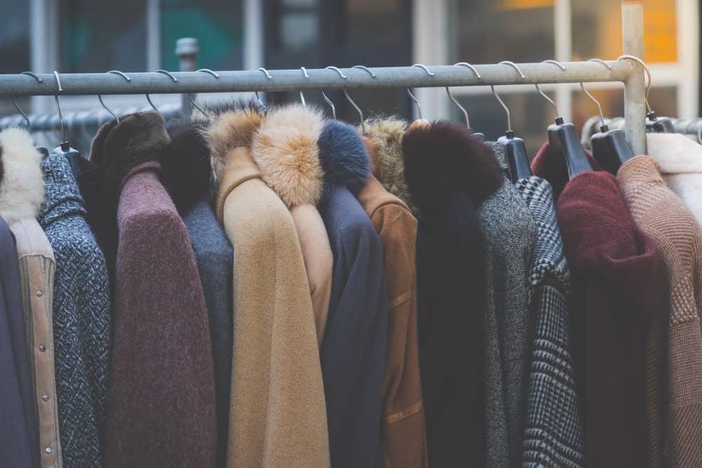 A close look at a rack of different coats.