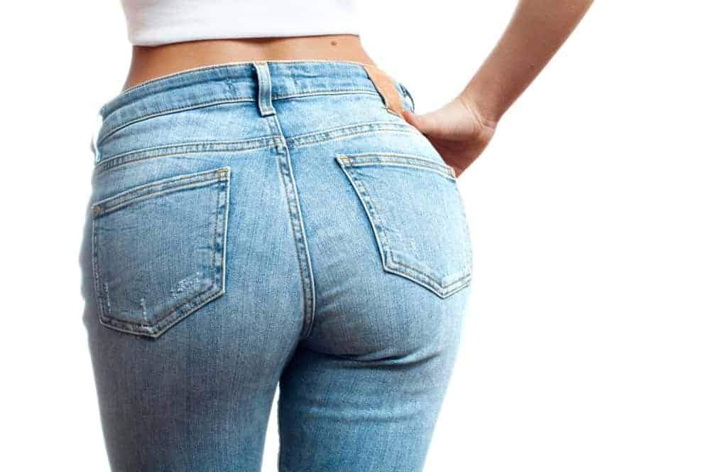 A close look at a woman wearing a pair of jeans.