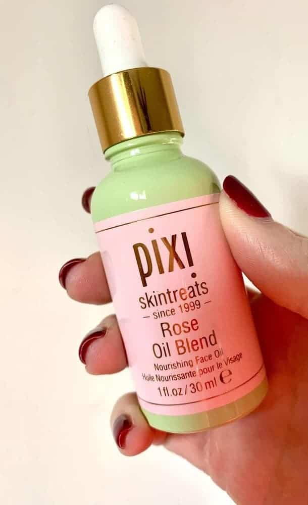 A close look at a bottle of Pixi rose oil blend from Allure beauty box.