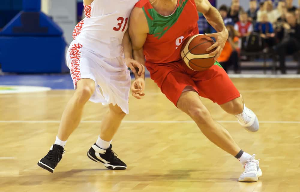 Players during basketball match.