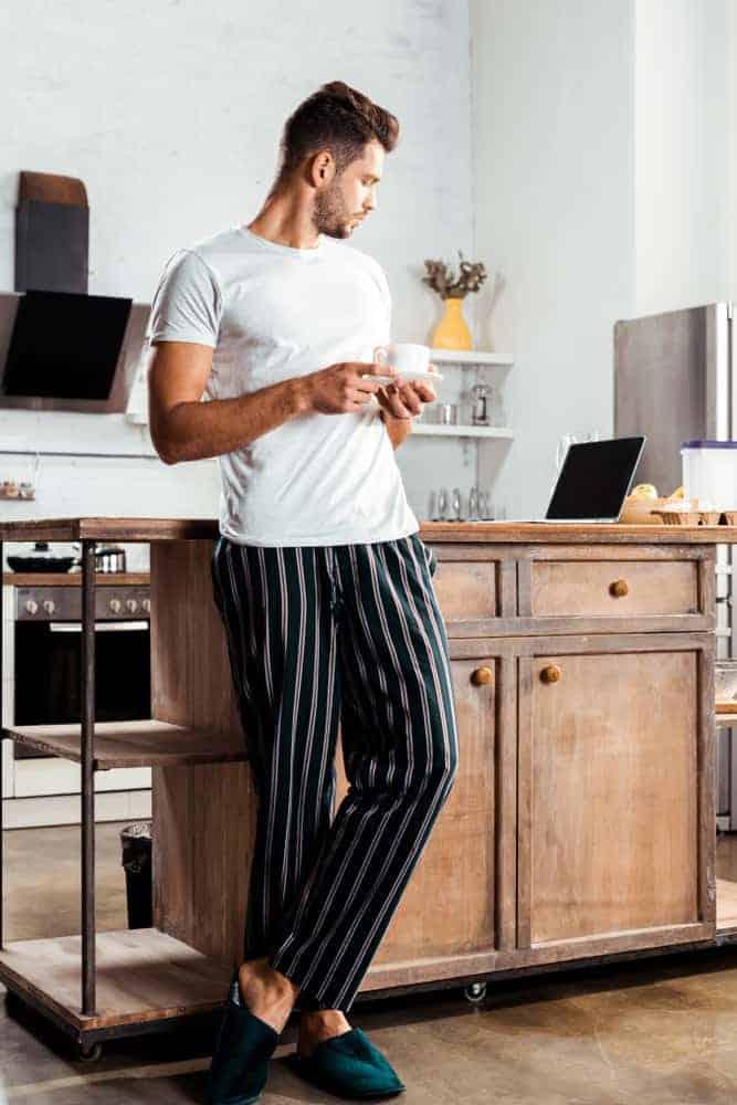 Man wearing t-shirt and pajama bottoms
