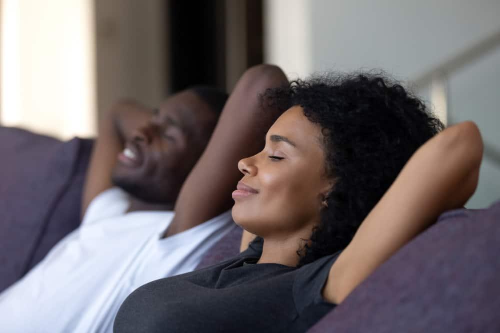 Man and woman lounging on sofa