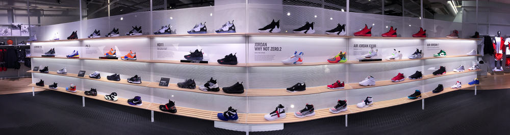 Large display of Nike sneakers and basketball shoes at the Nike Chicago Store.