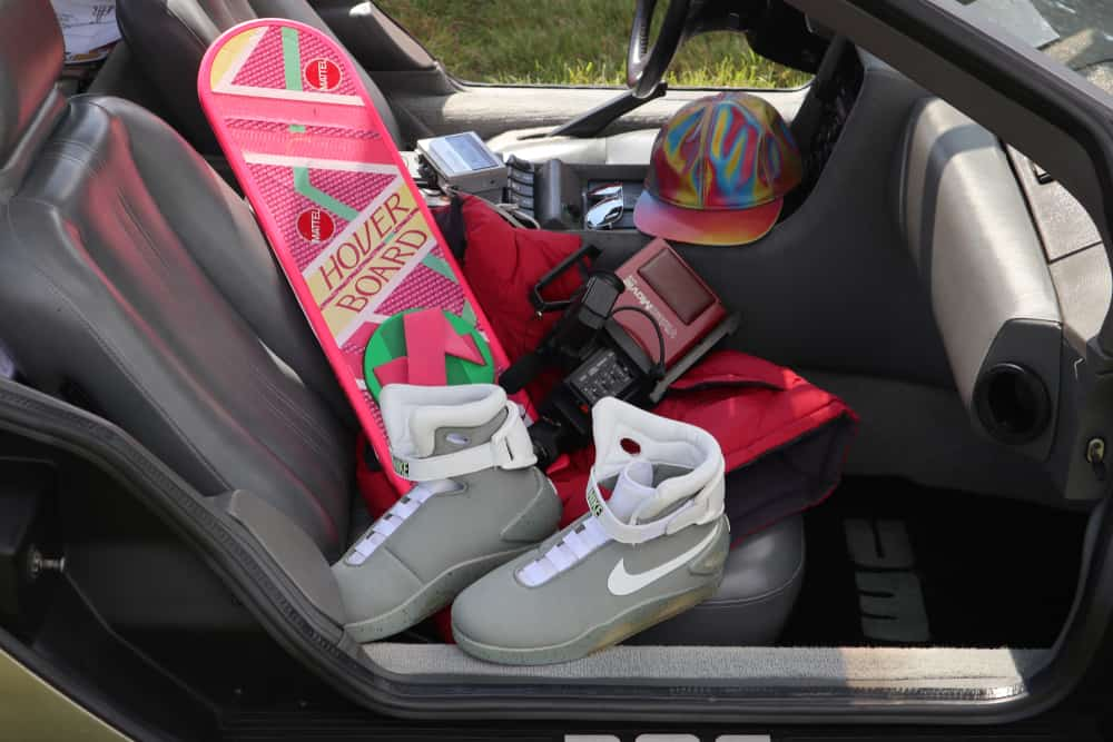 Nike Air Mag boots along with Hover Board and Sony video cam inside a car.