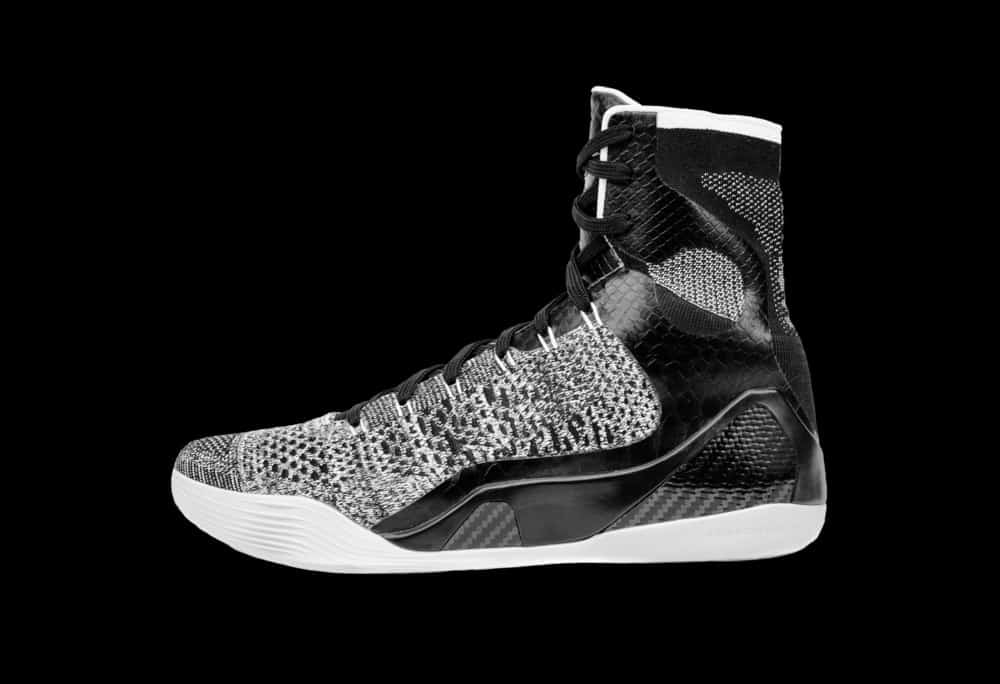 A close look at a gray and black high top basketball shoes.
