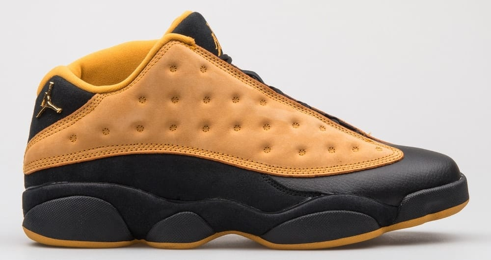 A close look at a yellow and black low-top basketball shoe.