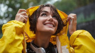 A close look at a woman wearing a raincoat.