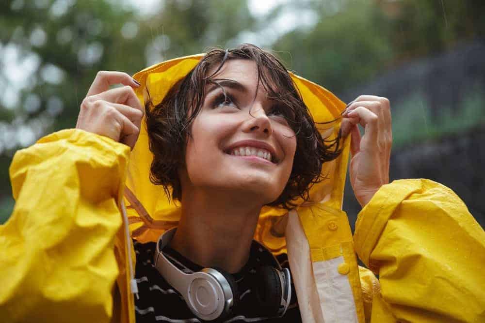 A close look at a woman wearing a raincoat.