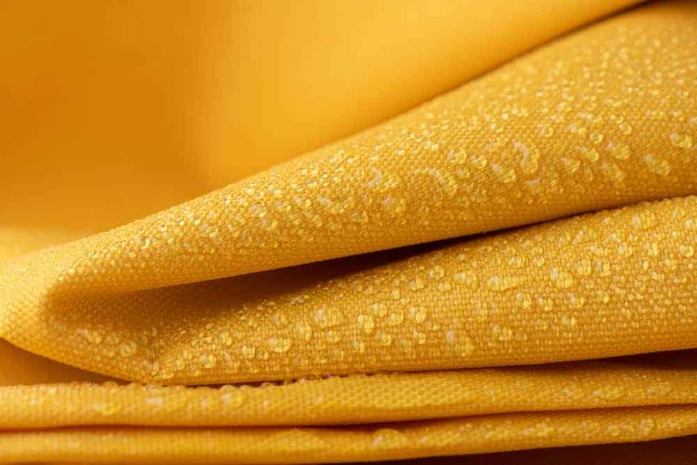 A close look at a yellow water-repellant material.