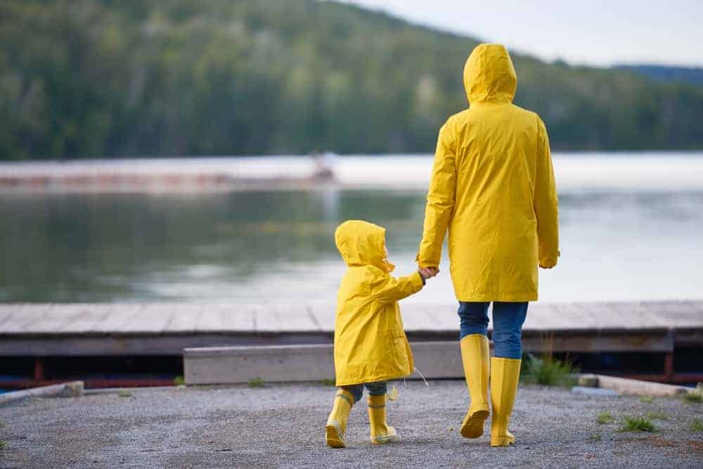 A mother and daughter wearing matching yellow raincoats.