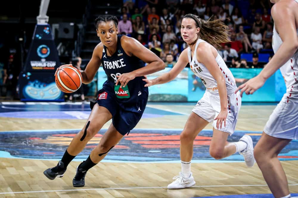 Basketball players Diandra Tchatchouang and Antonia Delaere in action during a basketball match.