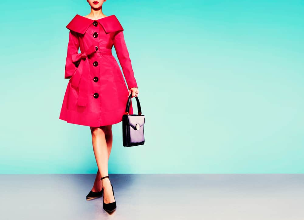 Woman in a red trench coat.
