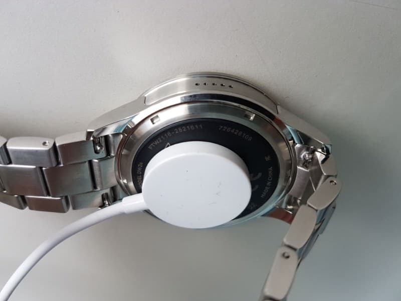 Fossil Q Founder 2 smartwatch with charger attached
