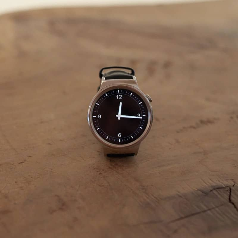 Huawei smartwatch on a wooden table.