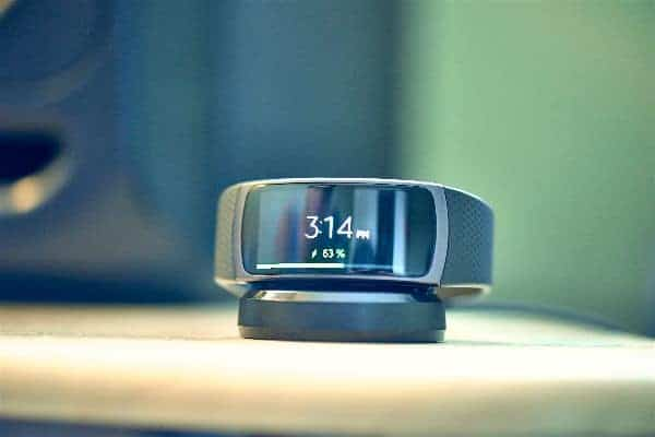 A close look at the Samsung Gear Fit 2 Smartwatch while charging.