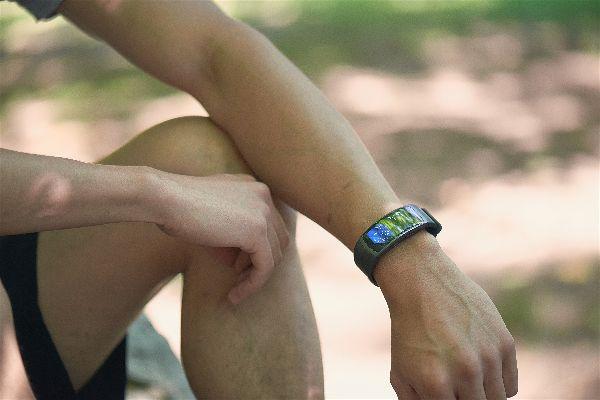 A man wearing the Samsung Gear Fit 2 Smartwatch.