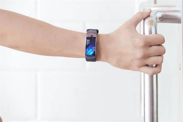 A man wearing the Samsung Gear Fit 2 Smartwatch on right wrist.