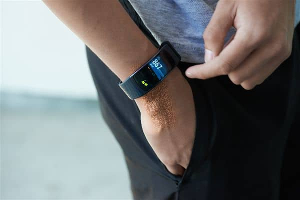 A man wearing the Samsung Gear Fit 2 Smartwatch on right hand in pocket.