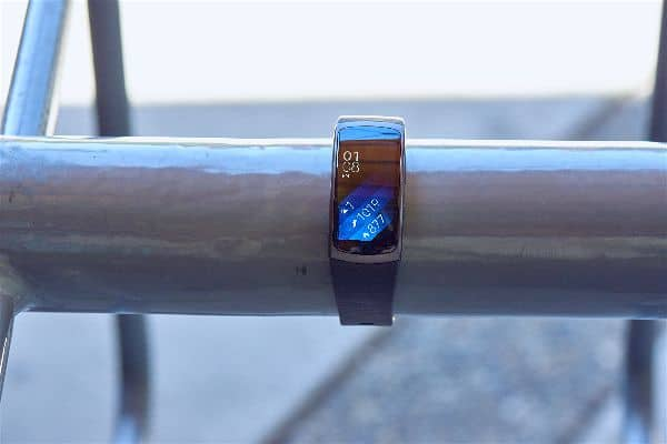 The Samsung Gear Fit 2 Smartwatch displayed on a tube.