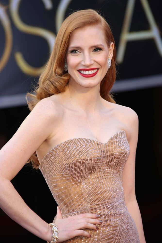 Jessica Chastain at the 85th Annual Academy Awards wearing a strapless dress.
