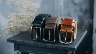 Three leather belts in various tones.
