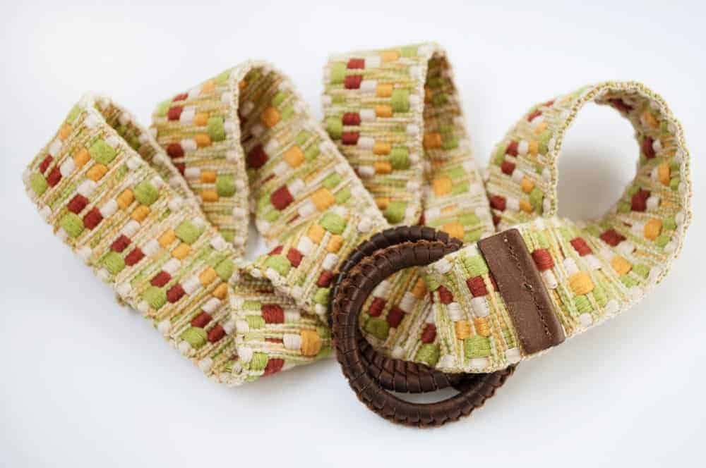 A close look at a colorful woven women's belt.