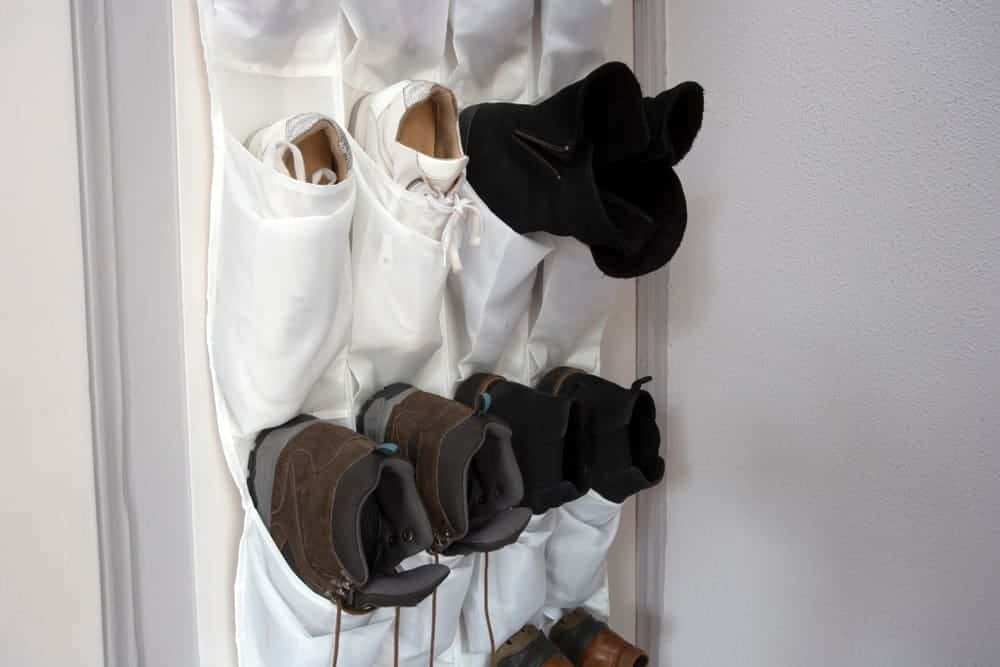 A close look at a set of shoe hangers for storing shoes.