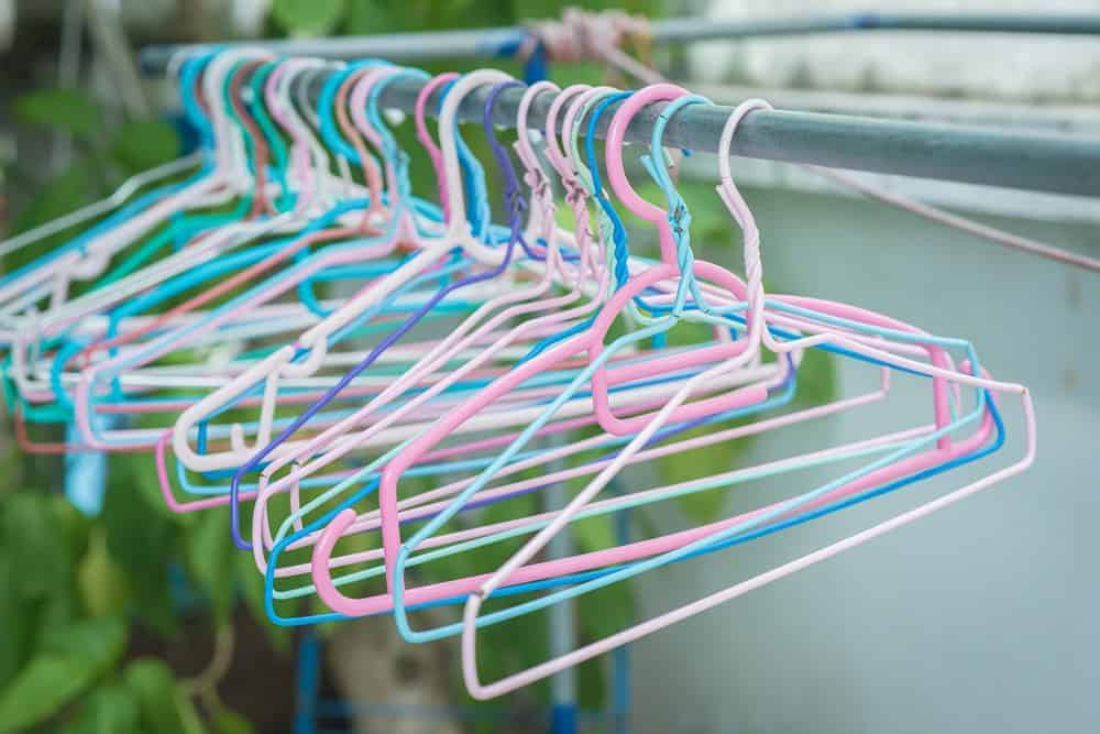 A close look at a set of colorful wire hangers.