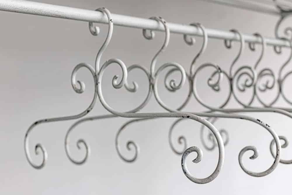 A close look at a row of vintage metal hangers.