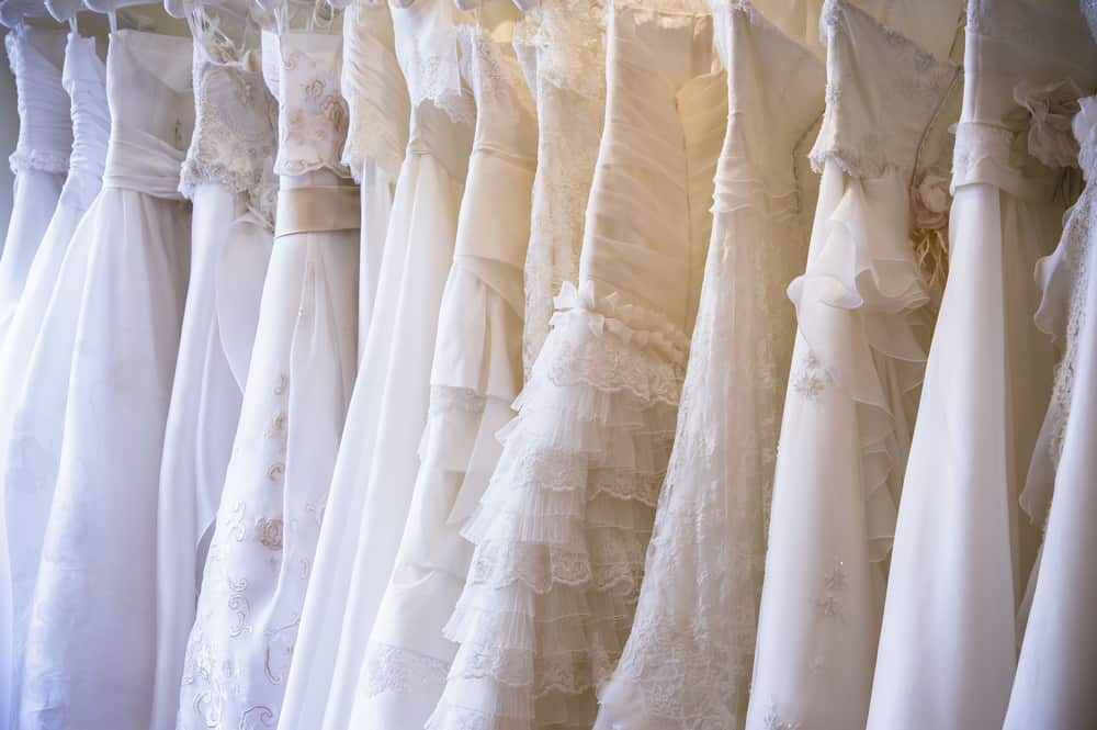 A collection of white wedding dresses.