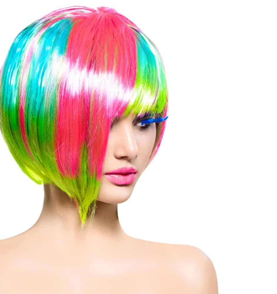 Model with colorful dyed hair in short bob and fringe.