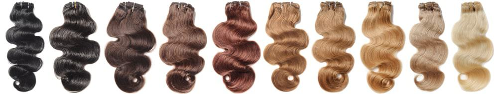 A line of clip-in hair extensions in different colors.