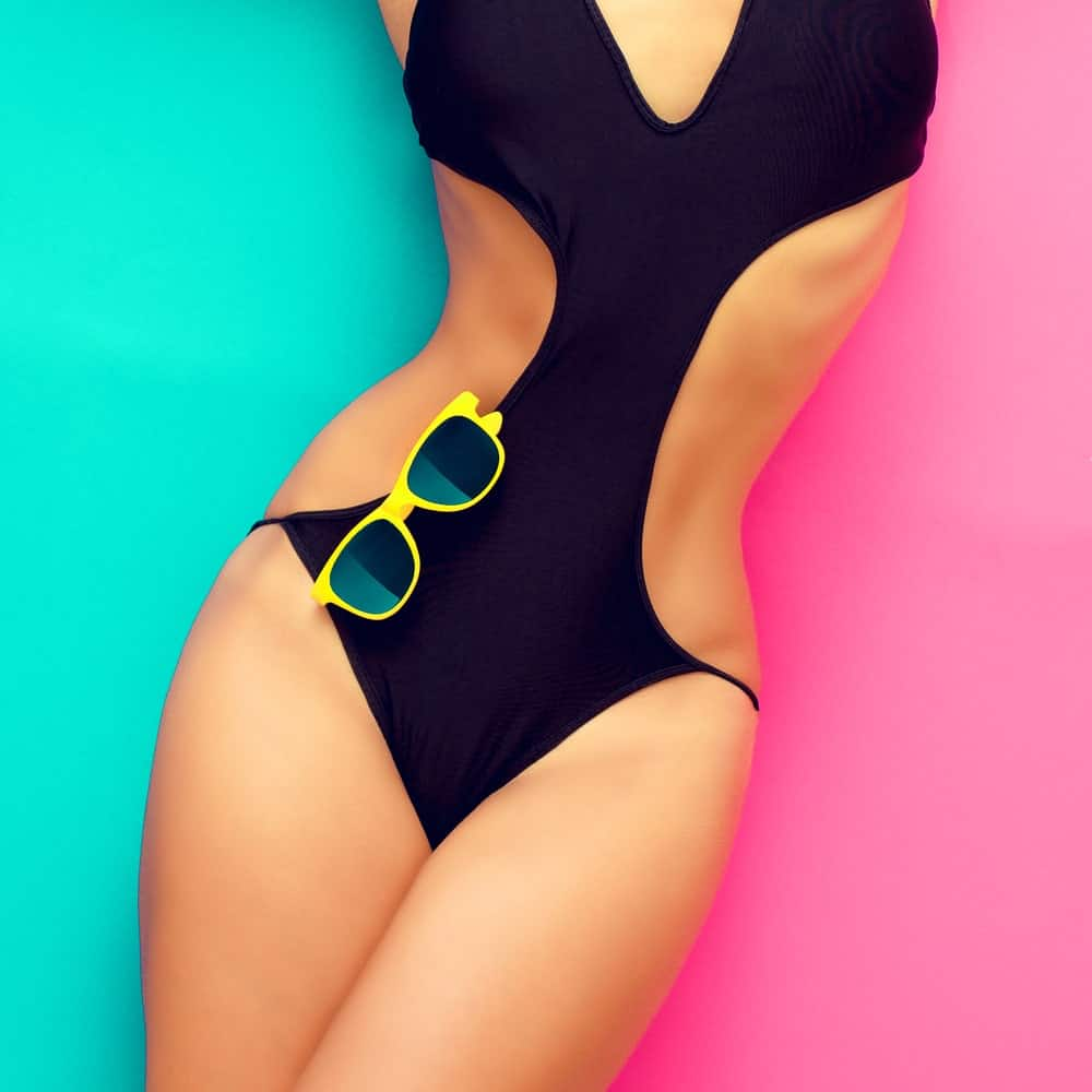 A close look at a woman wearing a sexy black monokini.