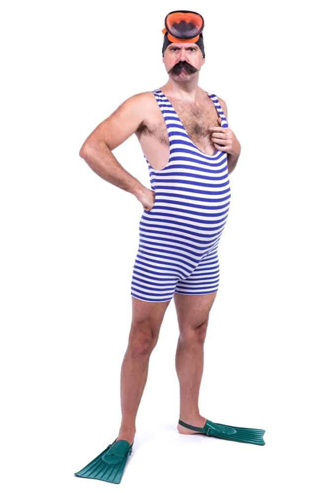 A man wearing vintage striped bathing suit.