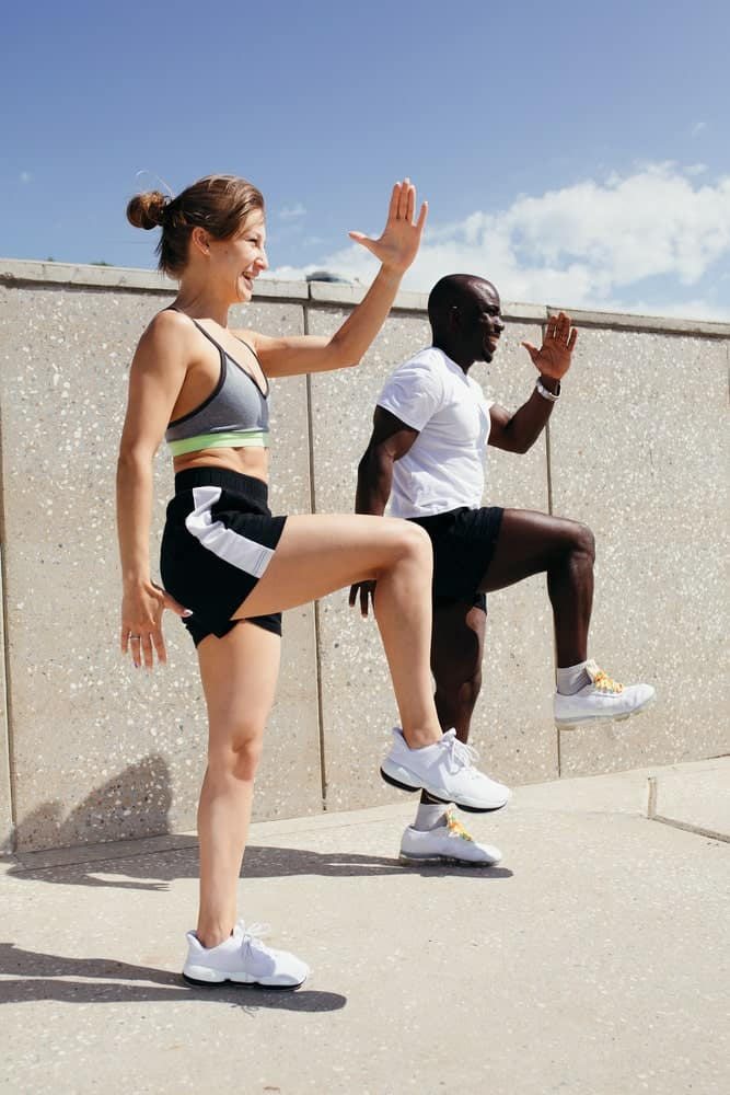 A couple wearing shorts while exercising.