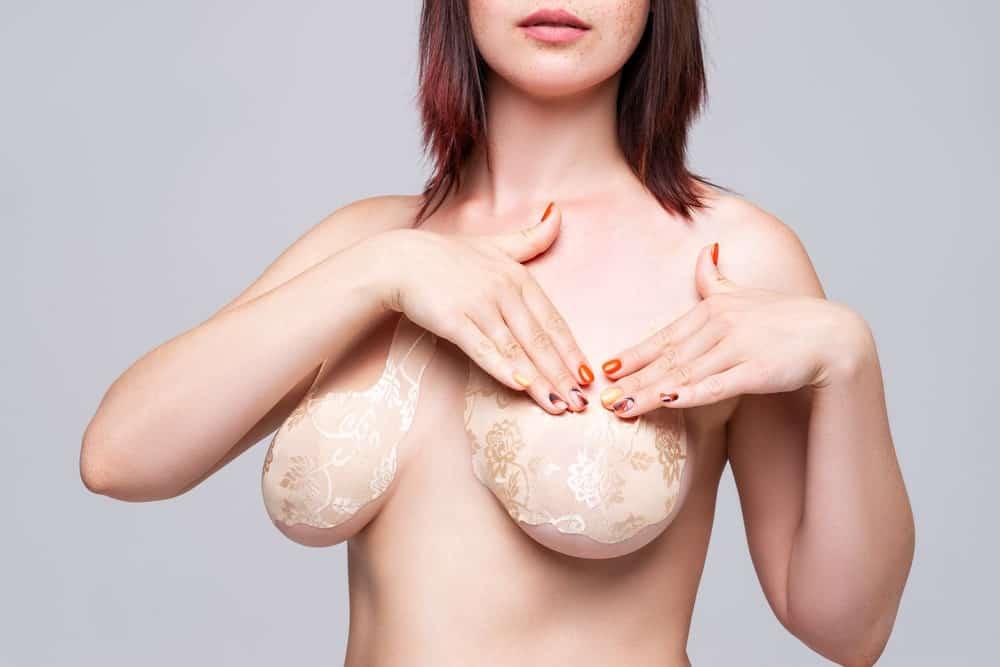 A close look at a woman wearing adhesive bra.