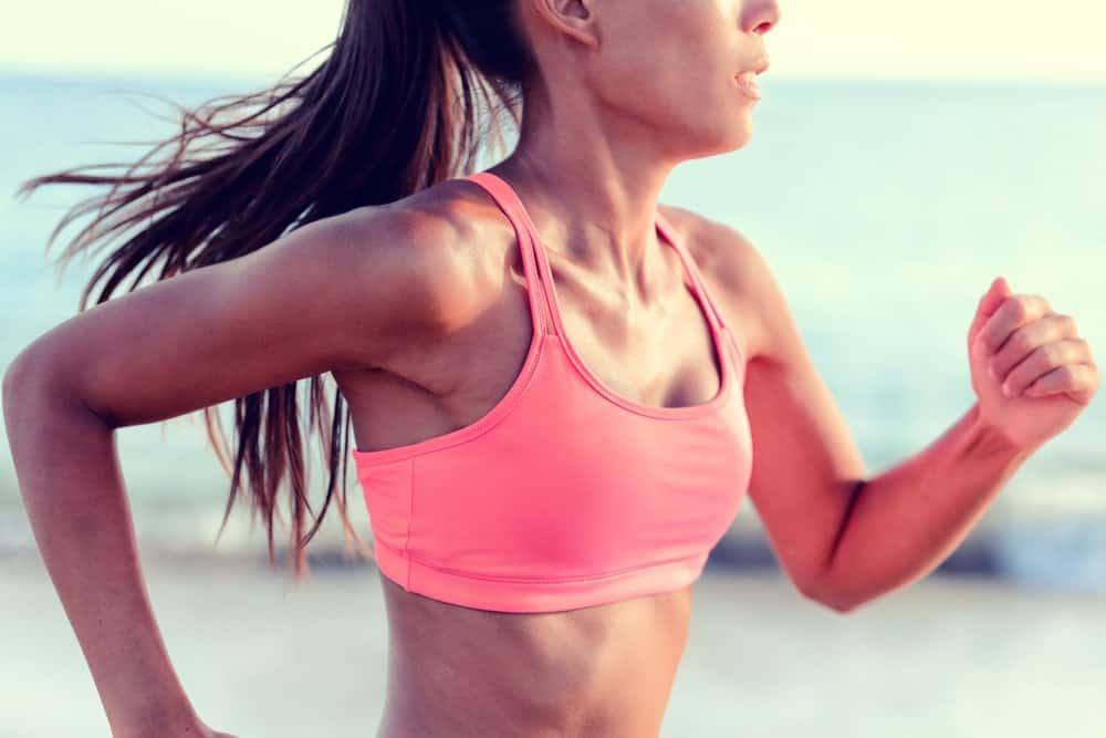 A runner wearing a pink sports bra.