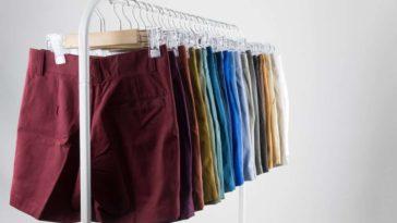 Pairs of chino shorts on display at a rack.