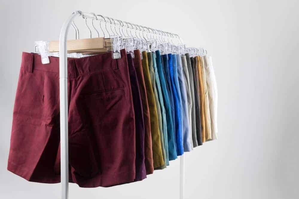 Pairs of chino shorts on display at a rack.