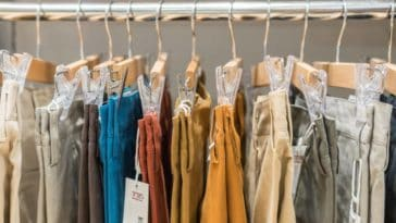 A rack of various chinos in display.