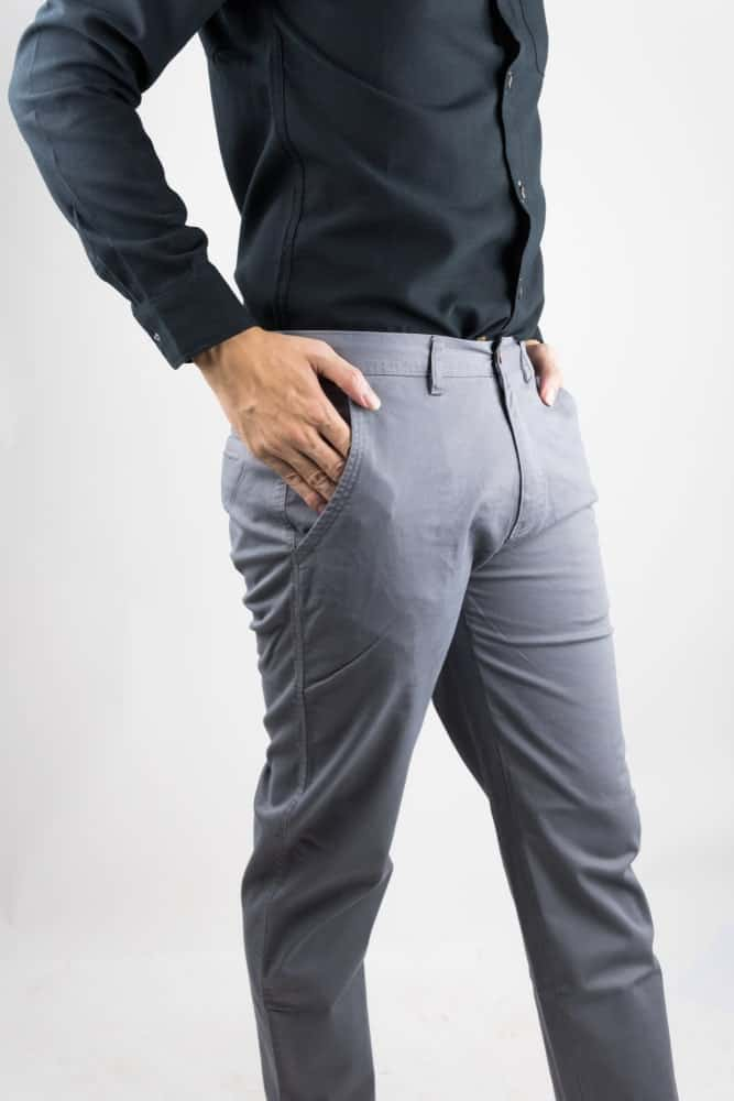 A close look at a man wearing light gray chinos.