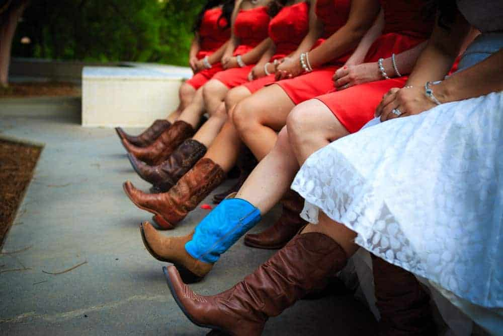 A close look at the bride and her brides maids wearing boots.