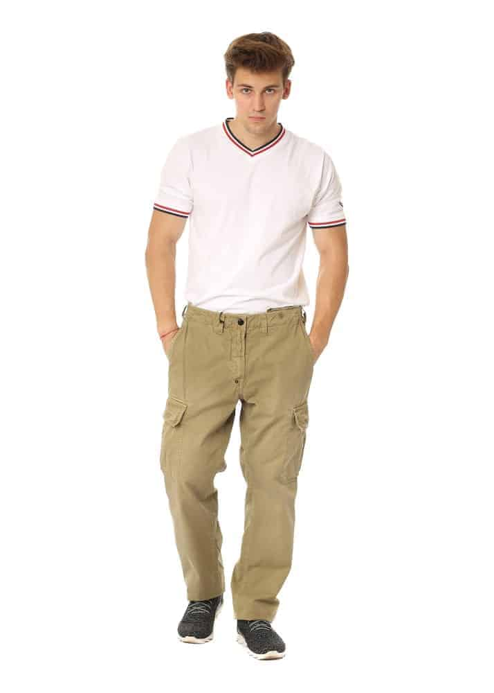 A man wearing a white shirt with his khaki pants.
