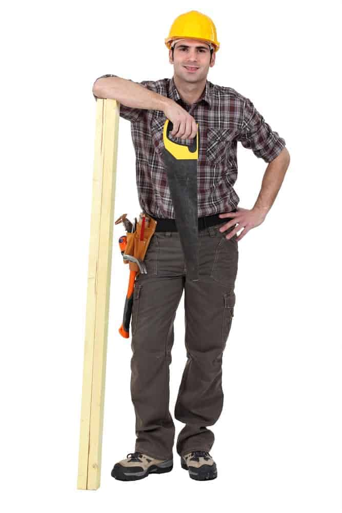 A close look at a contractor wearing khaki cargo pants.