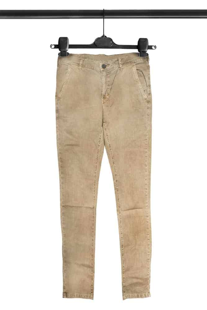 A close look at a pair of khaki pants on a hanger.