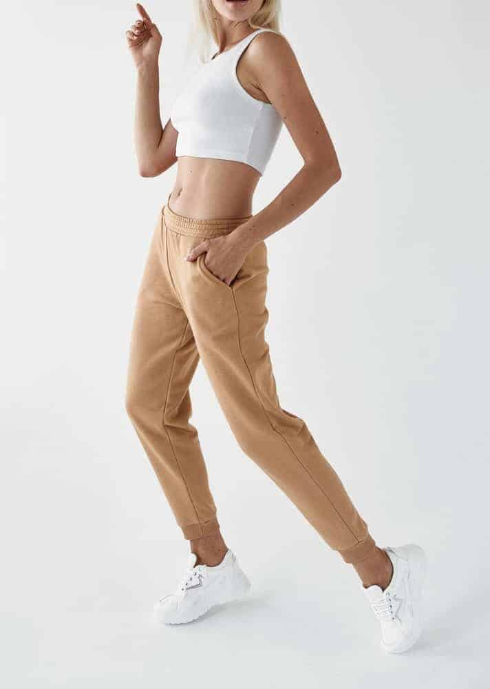 A woman wearing a pair of khaki joggers.
